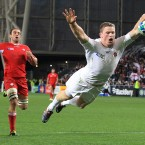 England's Chris Ashton celebrates as he scores against Georgia.
