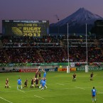 Wales and Namibia players contest the line-out against the backdrop of Mount Taranaki.