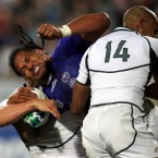 Samoa's Alesana Tuilagi is tackled by South Africa's Frans Steyn and JP Pietersen.