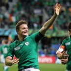 Brian O'Driscoll celebrates after Ireland's win against Italy.