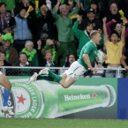 Keith Earls soars over the line to score for Ireland against Italy.