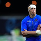 Italy's Sergio Parisse stands dejected after the game.