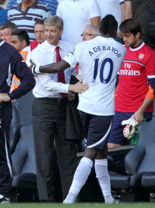 Arsenal manager Arsene Wenger shakes hands with his former striker at half time in yesterday's North London derby. Tottenham won the match  2-1.