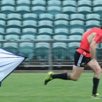 New Zealand's Conrad Smith runs with a parachute during training.
