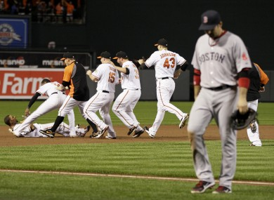 Boston leave the field after the Baltimore Orioles secure their post-season qualification.