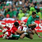 Ireland's Rob Kearrney is tackled by Wales' Mike Phillips and Toby Faletau.