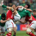 Ireland's Stephen Ferris is tackled by Wales' Sam Warburton.