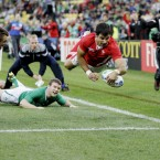 Wales' Mike Phillips is airborne as he scores a try.