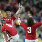 Welsh players celebrate after defeating Ireland.