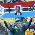 A South African fan waves a sign in the stands.