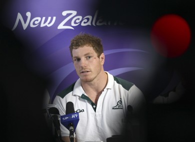 Pocock listens to questions at a press conference.