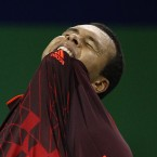 Jo-Wilfried Tsonga of France bites his jersey after losing a point to Kei Nishikori of Japan at the Shanghai Masters tennis tournament in Shanghai, China, Wednesday, Oct. 12, 2011. 