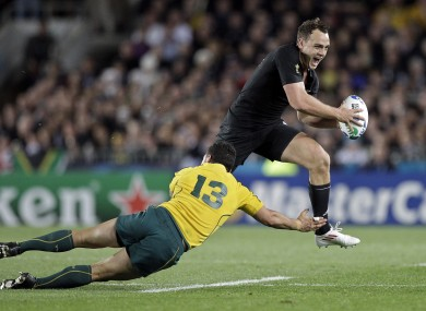 Israel Dagg skips his way past Australia's Anthony Faingaa.
