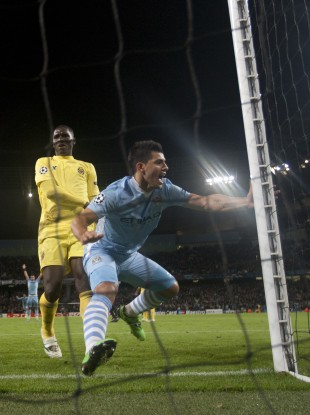 Agüero slots home the City's winner during last night's Champions League clash with Villareal.