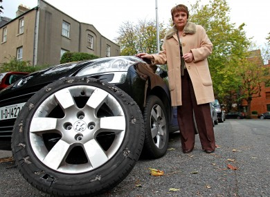 Dana stands by her campaign car and the badly damaged tyre.