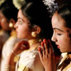 A young Dancer waiting off stage for her cue to perform prayers during the show highlighting Indian Culture at the RDS Dublin during the Festival of Lights or Diwali which is the biggest Indian festival of the year.