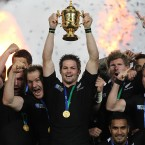It's ours! New Zealand captain Richie McCaw celebrates with his teammates.