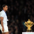 France's Thierry Dusautoir walks past the Webb Ellis Cup following Sunday's defeat to New Zealand.