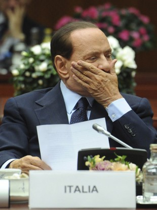 Silvio Berlusconi's coalition partners are dragging their heels on allowing the government to enact reforms demanded by the EU.