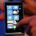 A Nokia employee demonstrates the Lumia 800 (AP Photo/Sang Tan)