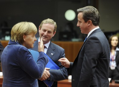 Enda Kenny speaks with Angela Merkel and UK PM David Cameron at last night's talks