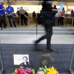 Flowers and a photocopy image of Steve Jobs at the Apple store in Sydney, Australia.  (AP Photo/Rick Rycroft)