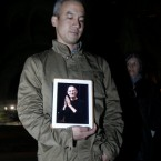 Conrad Corpus holds up an iPad with a photo of Steve Jobs on it at an iPhone vigil at Dolores Park in San Francisco. (AP Photo/Jeff Chiu)