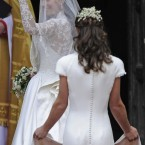 Kate Middleton, left, waves as she arrives at Westminster Abbey with her sister Pippa at the Royal Wedding with Britain's Prince William in London Friday, April, 29, 2011. (AP Photo/Martin Meissner)