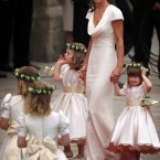 Pippa arrives with the bridesmaids and page. (AP Photo/Paul Rogers, Pool)
