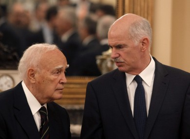 Greek Prime Minister George Papandreou, talking with the President Carolos Papoulias in June 2011