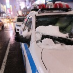 Snow is on an NYPD car in Times Square (AP Photo/Tina Fineberg)