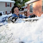 Mary Lou Wilder clears off her car in Cornwall on Hudson, New York (AP Photo/Lee Ferris)