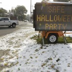 A sign announces a safe Halloween party to be hosted at the fire department in Paramus, New Jersey (AP Photo/Julio Cortez)
