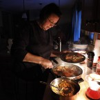 Tracy Ward, of Wilbraham, Massachusetts, prepares dinner by the light of lanterns for her family during a blackout in their home (AP Photo/Steven Senne)