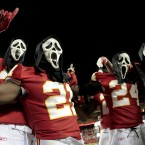 Wearing Halloween masks, Kansas City Chiefs players celebrate their overtime win against the San Diego Chargers.