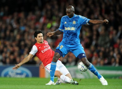 Arsenal's Mikel Arteta (left) and Marseille's Alou Diarra battle for the ball.
