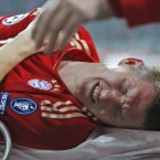 Bayern Munich's Bastian Schweinsteiger is substituted with a separated shoulder towards the end of Wednesday's Champions League match against Napoli