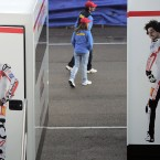 People walk past a giant portrait of deceased Italian motorbike rider Marco Simoncelli, right, before last weekend's Valencia Motorcycle GP, the final race of the season.