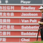 Keegan Bradley stands in front of the scoreboard during the second round of the HSBC Champions golf tournament in Shanghai.