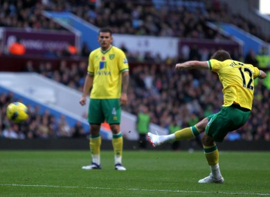 Anthony Pilkington curls home a free-kick for Norwich.