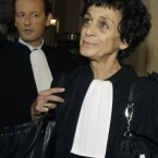 French lawyer Isabelle Coutant-Peyre speaks to reporters on her arrival at the court in Paris Monday Nov. 7, 2011 on the first day of a trial for four deadly attacks in France in 1982-1983. (AP Photo/Michel Euler)