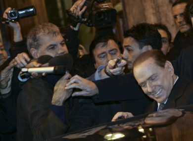 Berlusconi leaves the senate in Rome on Thursday.