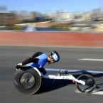 A wheelchair athlete crosses the Pulaski Bridge during the New York City Marathon. 