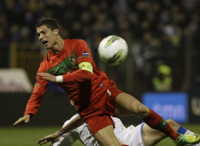 Ronaldo goes down under a challenge from Bosnia's Senad Lulic.