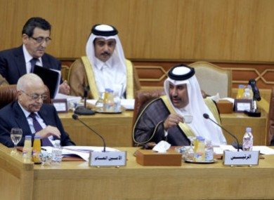 Qatari Foreign Minister Hamad bin Jasim, center, looks at Arab League secretary-general Nabil al-Arabi Nabil, left, during today's emergency meeting.