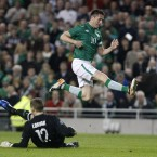 Ireland's Robbie Keane jumps the tackle from Estonia's goalkeeper Pavel Londak. 