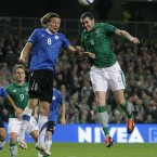 John O'Shea and Estonia's Vladimir Voskoboinikov battle for the ball.