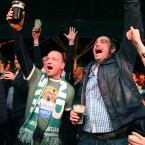Ireland football fans celebrate in Dublin as their team scores.