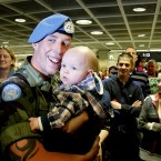 James Dunne is met by his son Andrew, at Dublin Airport. 