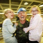 Cpl Wayne Fitzgerald from the 104th Infantry Battalion is greeted by his daughters Emma, six, left, and Eleana, eight, at Dublin Airport.